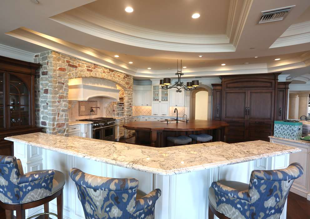 The custom kitchen area featuring stone and custom cabinets can be seen in the 39,000-square-foot home in Belleair Shore that Ben and Karla Mallah purchased from former Philadelphia Phillies slugger Ryan Howard for $16.5 million, the highest price for a home in the Tampa Bay/Sarasota area. [SCOTT KEELER | Times]