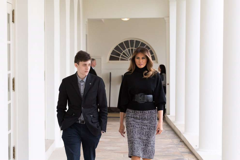 First lady Melania Trump walks Kyle Kashuv, a junior at Marjory Stoneman Douglas High School student, to meet the president. [Official white House photo by Andrea Hanks]