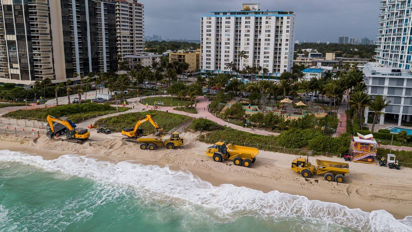 The U.S. Army Corps of Engineers dumps new sand from Central Florida along the Miami Beach shoreline near 65th Collins Avenue on Monday.