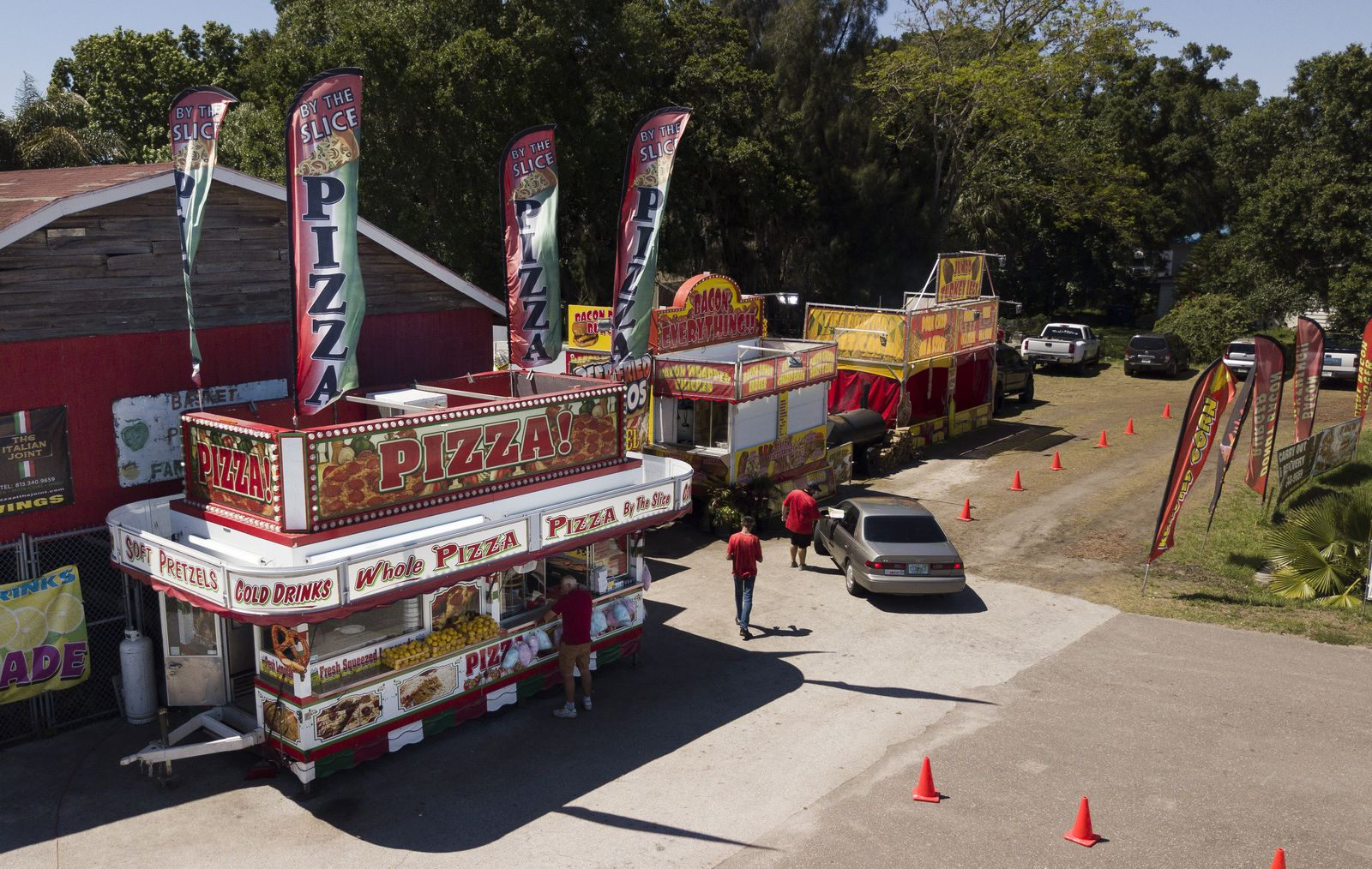 The scene as cars order in the drive thru at Taste of the Fair at 11347 US-301 on the site of a produce market at the corner of U.S 301 and Symmes Road on Monday, April 27, 2020 in Riverview. [DIRK SHADD | Times]