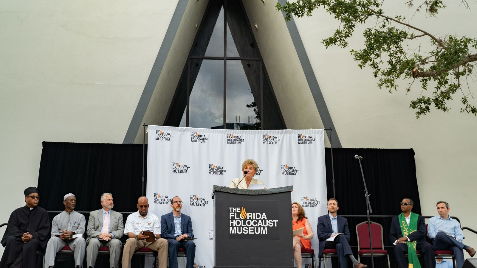 Holocaust survivor Toni Rinde shares her story during a Unite Against Hate vigil outside the Florida Holocaust Museum Thursday in St. Petersburg.
