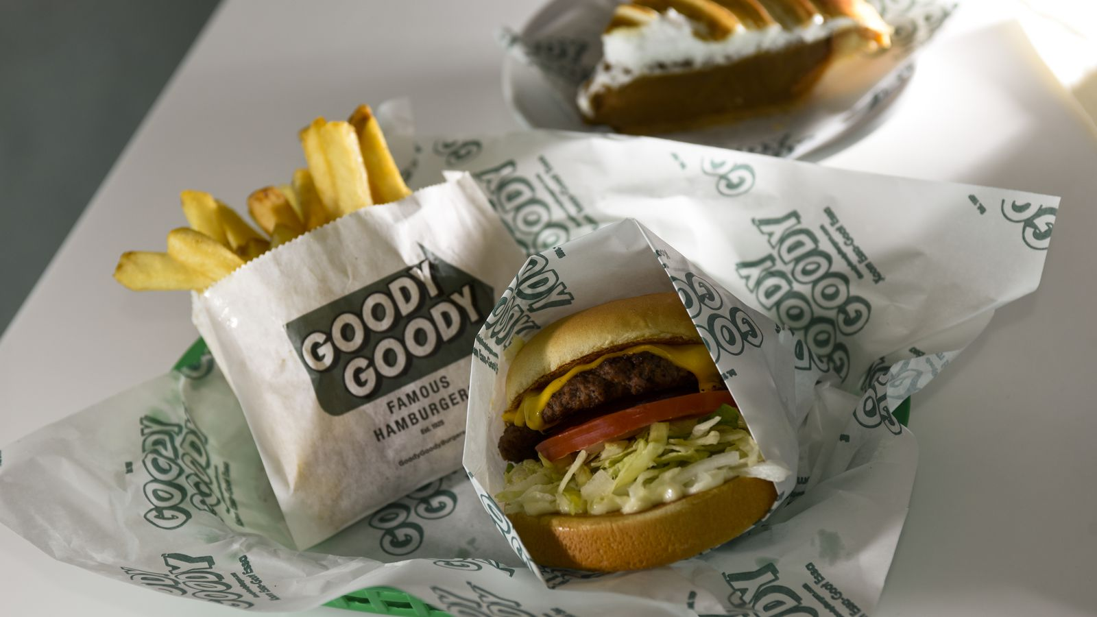 Goody Goody is among the Tampa International Airport restaurants offering touchless airside delivery through the airport's new TPA to Go program. Shown here are Goody Goody's Hyde Park burger, french fries and butterscotch pie, photographed at the airport in 2018.