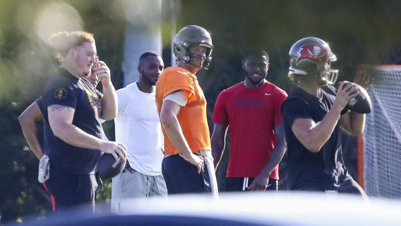Tampa Bay Buccaneers center Ryan Jensen, far left, along with safety Mike Edwards, second from left, quarterback Tom Brady, center in orange, cornerback Jamel Dean, second from right, and quarterback Blaine Gabbert are seen during a private workout Tuesday, June 23, 2020 at Berkeley Preparatory School in Tampa.