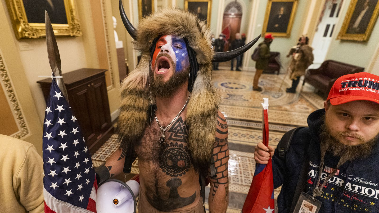 A supporter of President Donald Trump chants outside the Senate Gallery inside the Capitol, Wednesday in Washington.