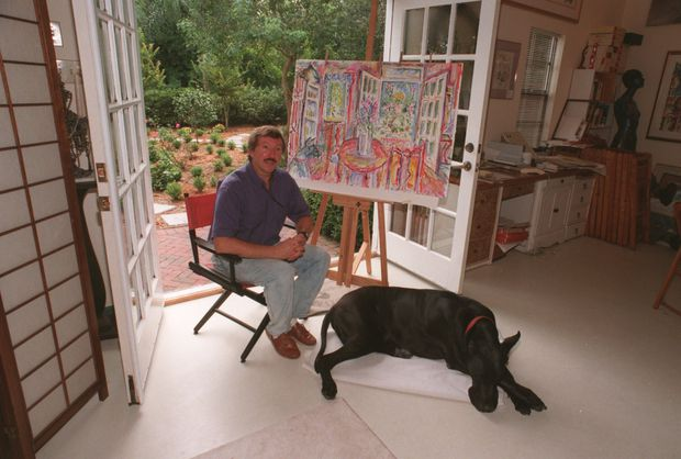 Artist Peter Stilton, and his Great Dane Barkley poses in his home studio in 2004.