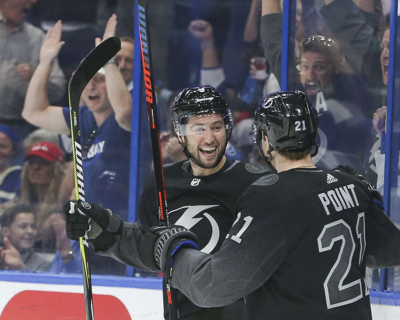 82cd008963d Tampa Bay Lightning center Tyler Johnson (9) celebrates his goal with center  Brayden Point