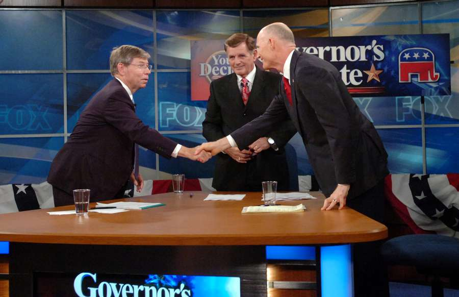 Republicans Attorney General Bill McCollum, left, and Rick Scott, right, square off in a governor's candidate debate as Fox News' John Wilson moderates at WVTV Fox13, in August 2010 in Tampa. (Times files)