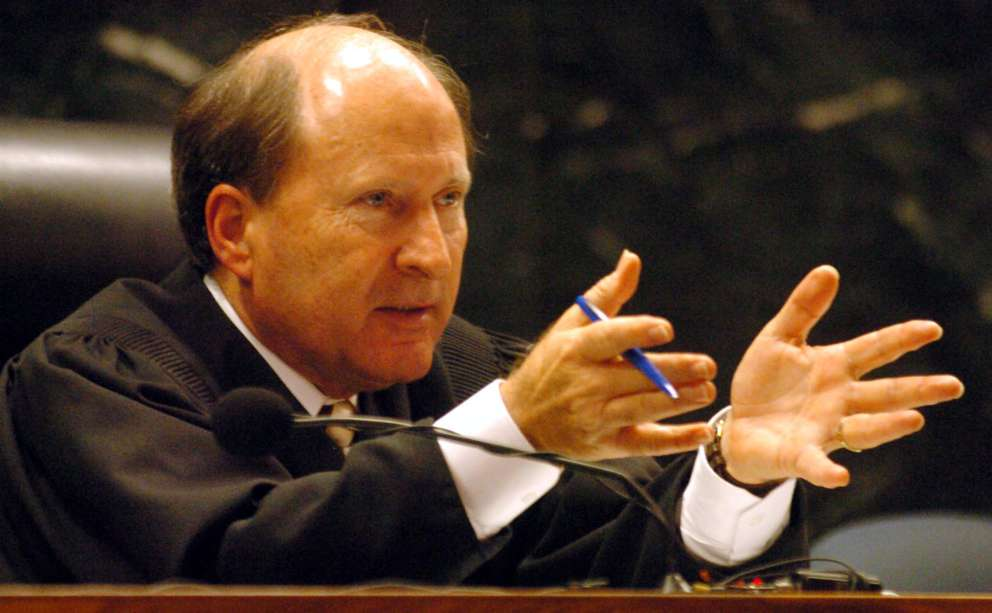 Judge George Greer talks with attorneys during a hearing in the Schiavo case. Times (2005)