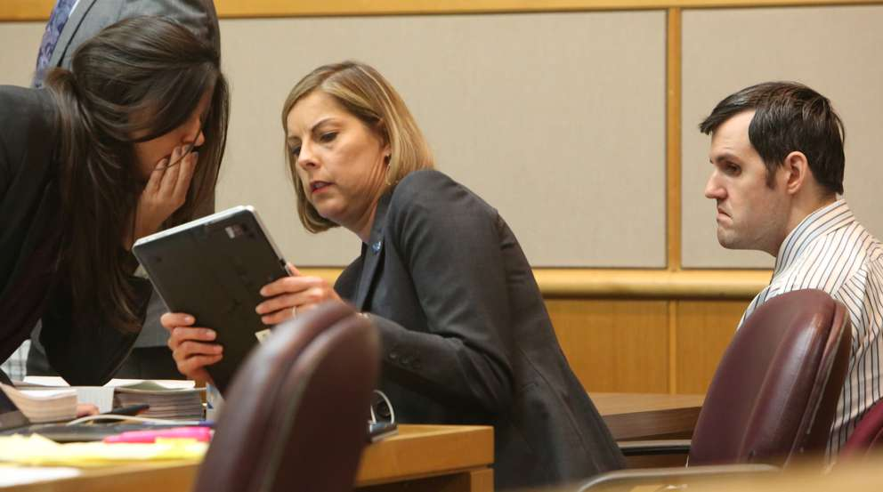 Public defenders Jessica Manuele and Jane McNeill look at a tablet as defendant John Jonchuck waits for his trial to start up after a lunch break Thursday afternoon. SCOTT KEELER | Times