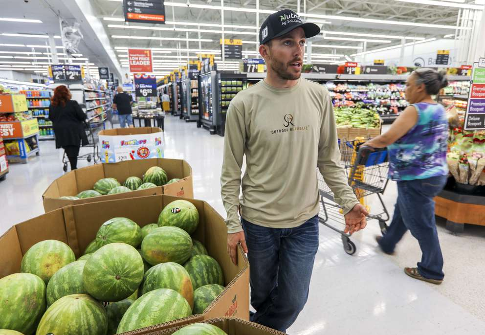NASCAR driver Ross Chastain stands near a display of watermelons Monday, July 1, 2019 at a Walmart in Tampa. Chastain's family grow watermelon at a farm in Punta Gorda which supply watermelon to Walmart. CHRIS URSO   Times