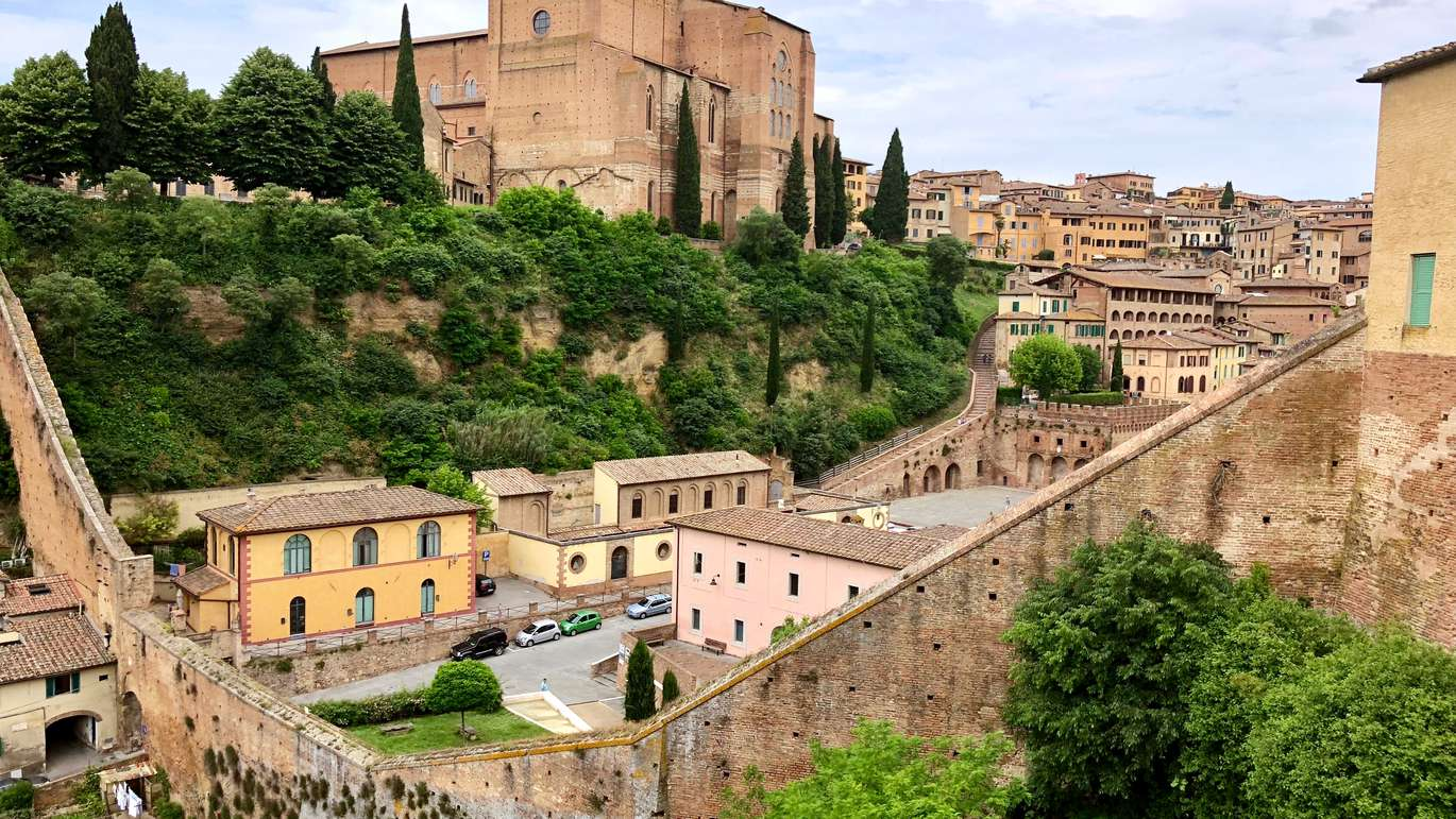 The city of Siena in Tuscany, Italy with its medieval stone buildings. There is so much to a view like this, and yet all I can think of is an ideal simplicity.