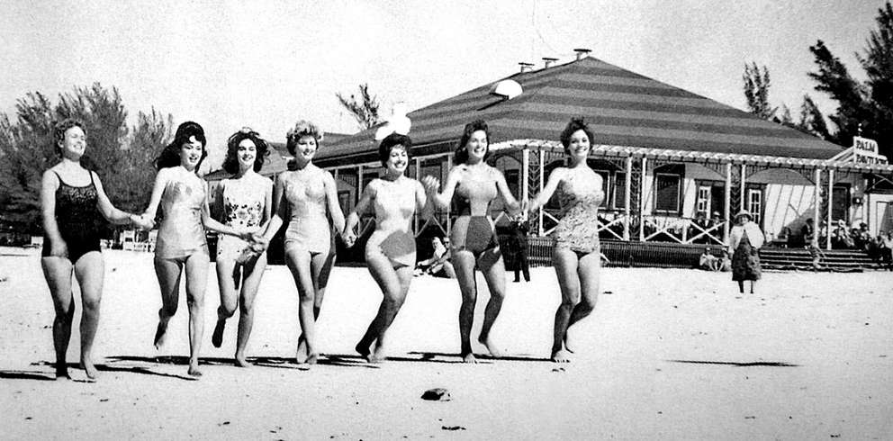 Contestants in the 1961 Tri-City Suncoast Fiesta, take a run on Clearwater Beach near the Palm Pavilion restaurant and bar in this publicity photo. Courtesy of Arcadia Publishing.