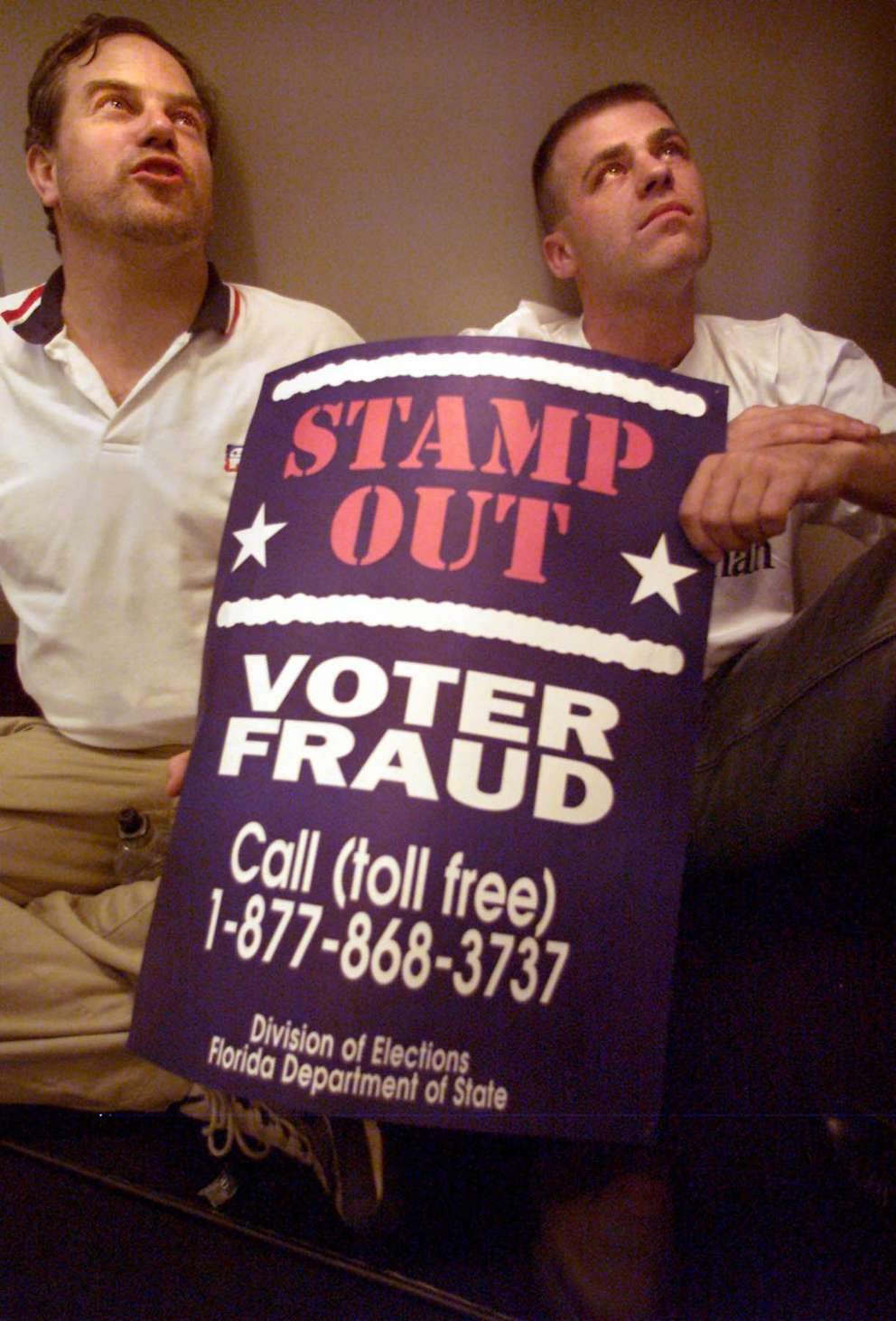 For Dade by Carl Juste/mhs, Office of Elections, County Hall, Stephen P. Clark Center, Downtown Miami, 11/22/00 — Republican party observers Brendan Quinn(left) and Bruce Tague (right) both from New York state joined the impromptu side-in outside the Miami – Dade County's elections office. Republic observers demanded to be allowed to observe the counting of the 10,700 ballots. The Canvassing Board suspended the manual counting of Miami – Dade County's ballots and will only count the undercounted ballots.