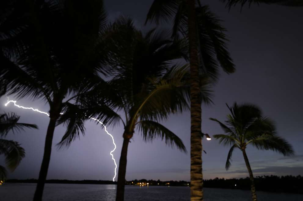 Lightning is seen over Biscayne Bay in Coral Gables, Fla. (AP Photo/Charles Dharapak)