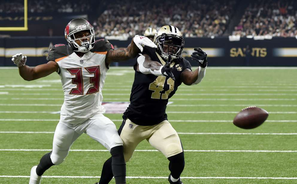 Bucs cornerback Carlton Davis (33) breaks up a pass intended for New Orleans Saints running back Alvin Kamara (41) in the first half. [AP Photo/Bill Feig]