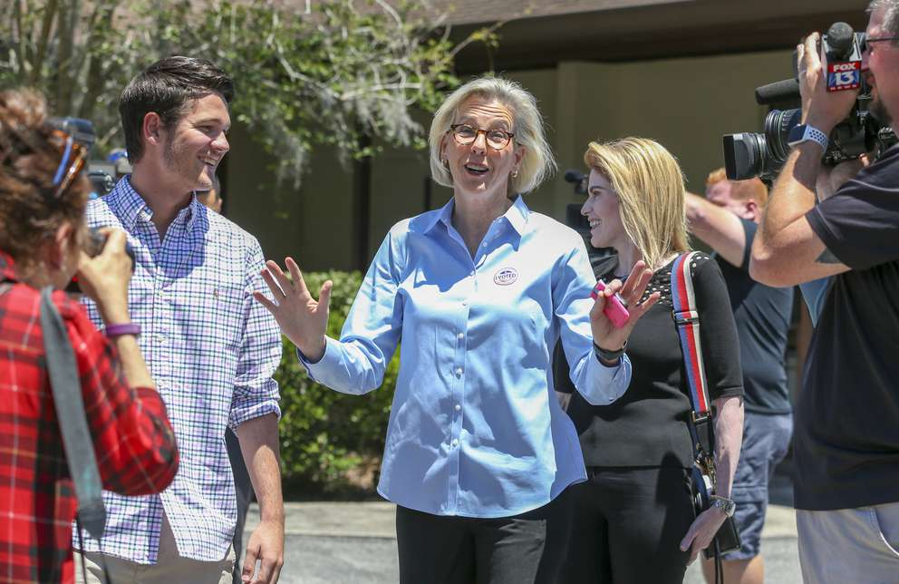 Tampa's next mayor, Jane Castor, center, spoke to photographers after voting at her polling precinct earlier Tuesday. [CHRIS URSO | Times]