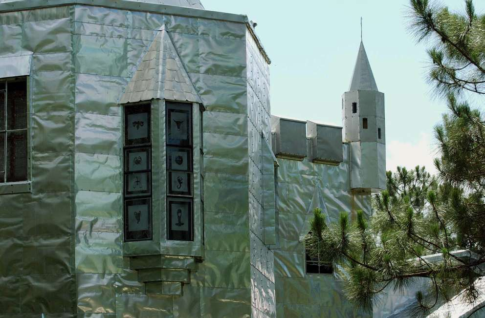 This is a view of Howard Solomon's castle. The wall gets their shiny look from the use of old metal metal printing plates. Solomon calls his work a hobby that got out of hand, speaking of the castle, museum and restaurant he built in the middle of nowhere, which is part studio and part bizarre tourist attraction in Ona, Florida. [PHIL SHEFFIELD | Times]