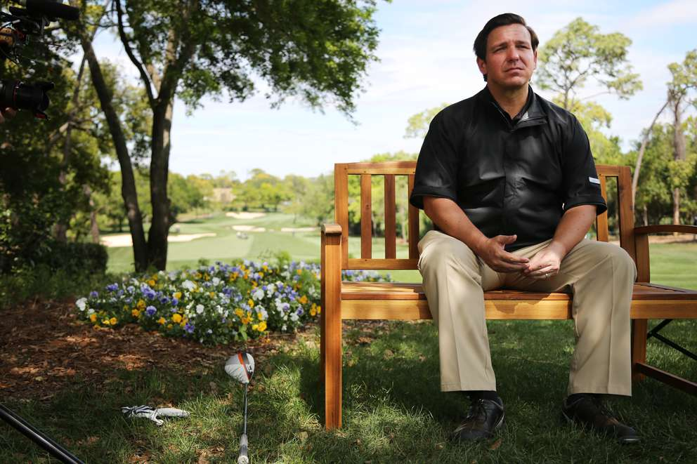 Florida Governor Ron DeSantis sits for an interview at the 1st hole on Monday while participating in the Veterans Alternative Celebrity Pro-Am at the Valspar Championship at the Innisbrook Golf Resort in Palm Harbor. [DOUGLAS R. CLIFFORD | Times]
