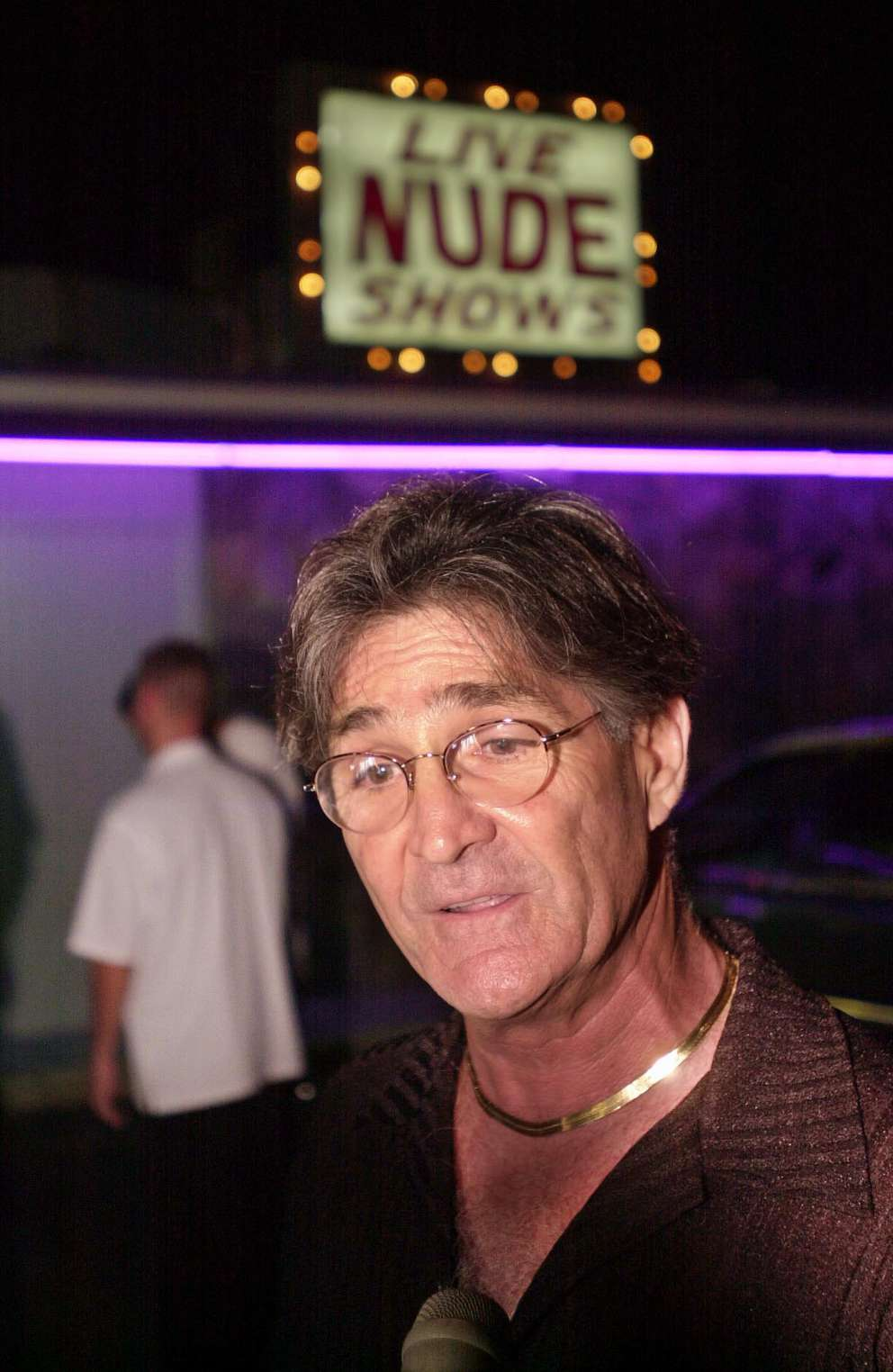 Joe Redner stands outside the Mons Venus after Tampa Police dragged dozens of his dancers from his club in handcuffs. Times (2000)