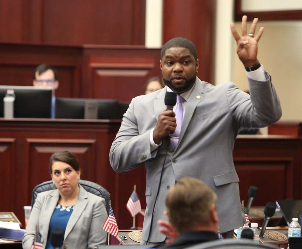Rep. Byron Donalds, R- Naples, speaks in favor of a bill to arm teachers in public schools on the House floor, Wednesday, May 1, 2019. In the back is the bill sponsor Rep. Jennifer Sullivan, R- Mt. Dora. The bill passed the House.