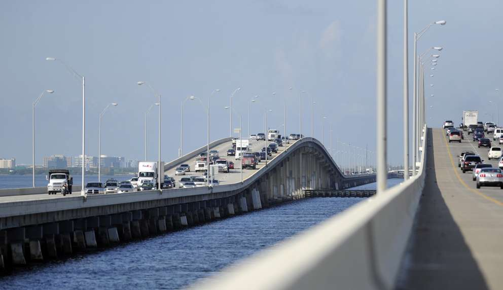Traffic crosses the hump on the eastbound Howard Frankland Bridge on the left side of the image. Times (2018)