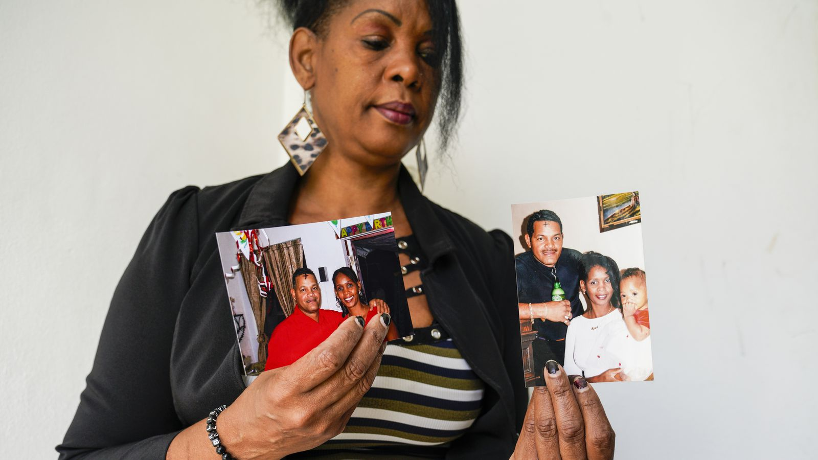 Magaly Terry-Gonzalez shows pictures of her husband, Eliseo De La Guardia, who died in 2013 when he was electrocuted by a power line while picking avocados. | [MARTHA ASENCIO-RHINE | Times]