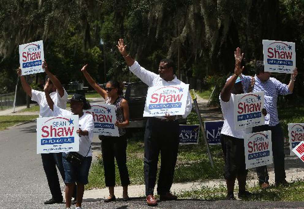 Sean Shaw (center) campaigning in 2014 at the Fair Oaks Community Center on 34th Street in east Tampa. [SKIP O'ROURKE | Times]
