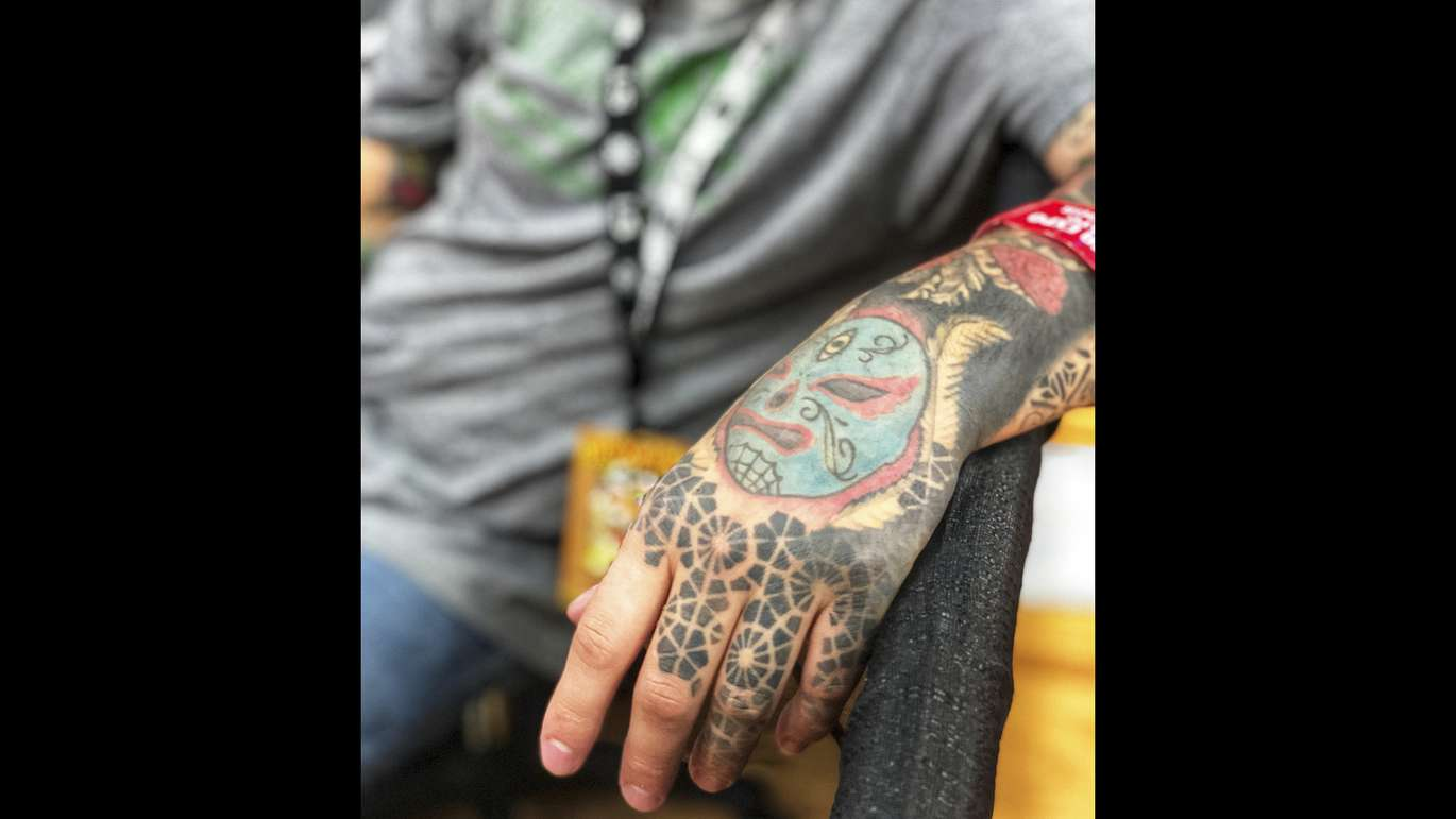 Damien Reichenbach, from Tampa has been doing tattoos for 7 years. He's one of many tattoo artists, vendors, and general enthusiasts at the annual event, Ink Mania Expo taking place in the Coliseum, St. Petersburg. MARTHA ASENCIO RHINE   Times