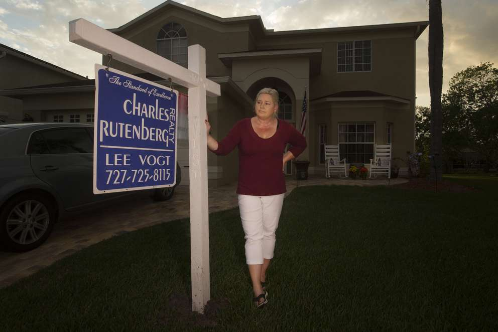 Terry Power's girlfriend, Delores Trott, stands in front of their Florida home in late February. The couple plans to live in Texas, for now. JOHN PENDYGRAFT | Times