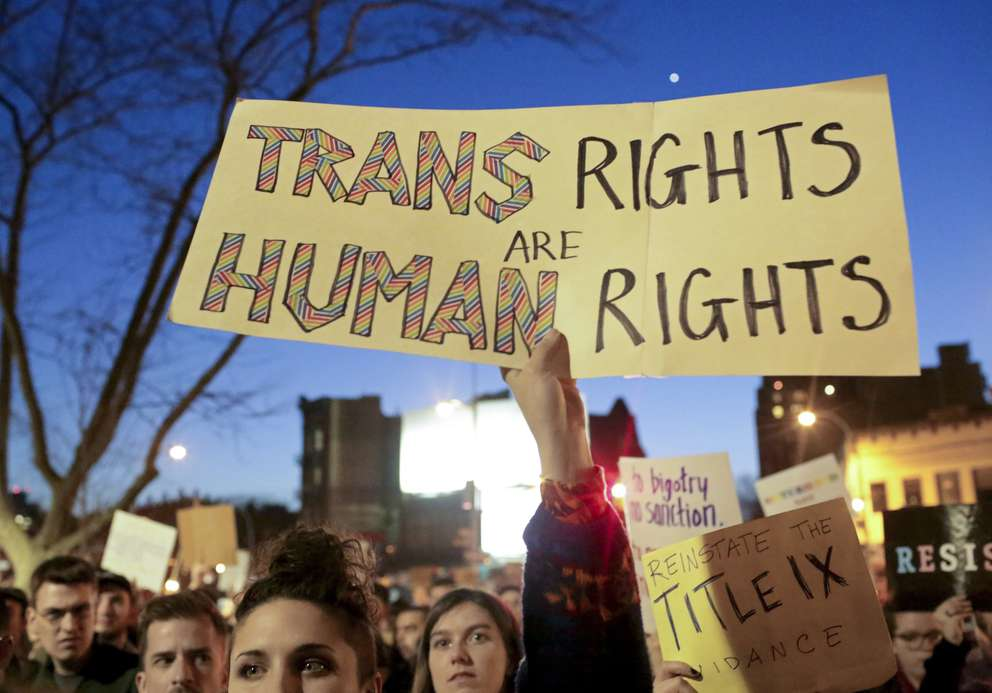 Hundreds of demonstrators protest a Trump administration announcement that reversed an Obama-era order allowing transgender students to use school bathrooms matching their gender identities, outside of The Stonewall Inn in New York, Feb. 23, 2017. Activists in the LGBTQ community mobilized a fast and fierce campaign on Oct. 21, 2018, to say transgender people cannot be expunged from society, in response to an unreleased Trump administration memo that proposes a strict definition of gender based on a person's genitalia at birth. [New York Times Files]