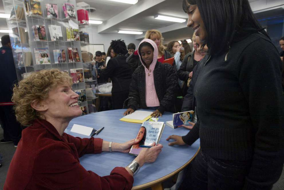 Author Judy Blume sign copies of her books during a book signing event in New York, Tuesday Nov. 16, 2004. [Bebeto Matthews | AP]