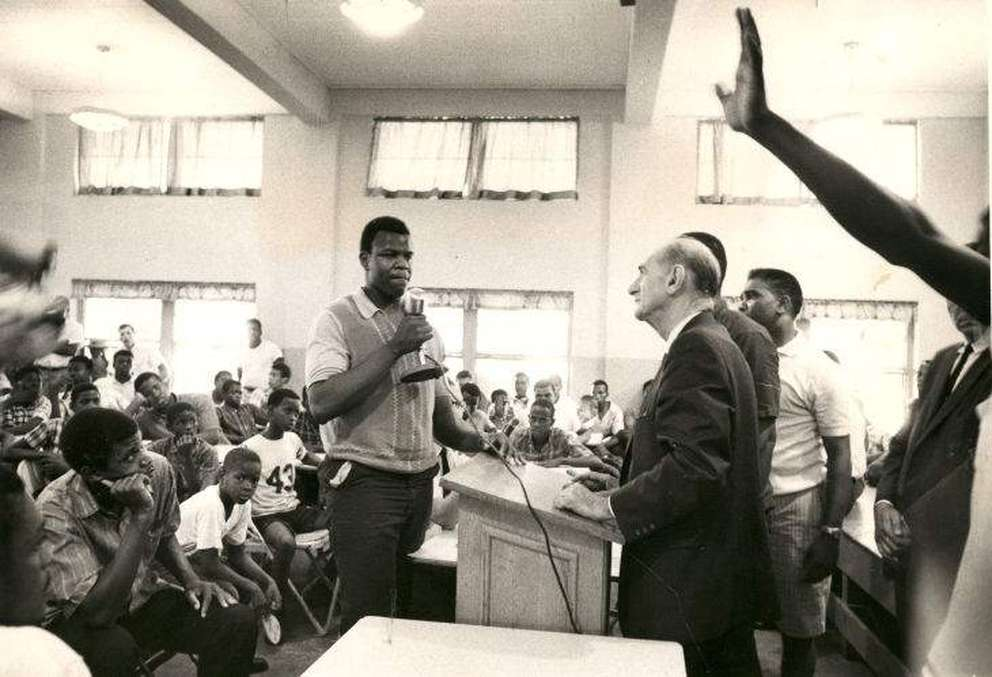 Tampa Mayor Nick Nuccio listens to an airing of concerns at a school as part of the citry's response to the June 1967 riots. Civil rights leaders say resentment at local discrimination had long been building when a fatal shooting touched off the violence. Times (1967)