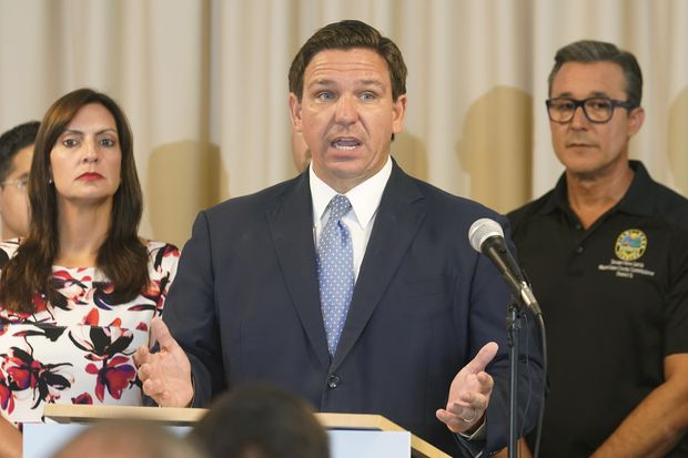 Florida Gov. Ron DeSantis answers questions related to school openings and the wearing of masks Tuesday in Surfside.