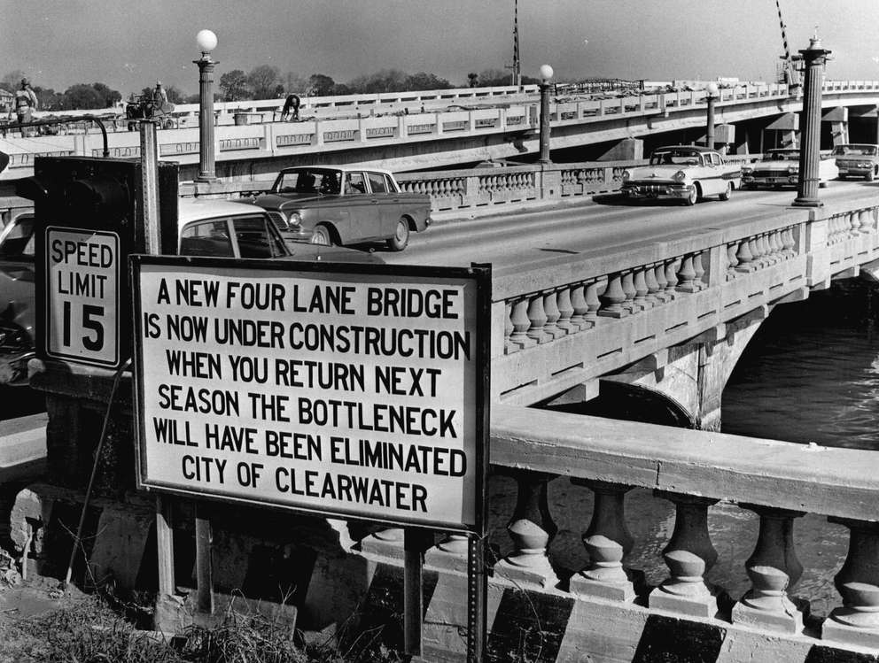 In winter 1962, the city of Clearwater erected this sign at the west end of the bridge to assure departing visitors better things were coming. The sign gave the same assurance as vehicles still use the old bridge. Times (1963)