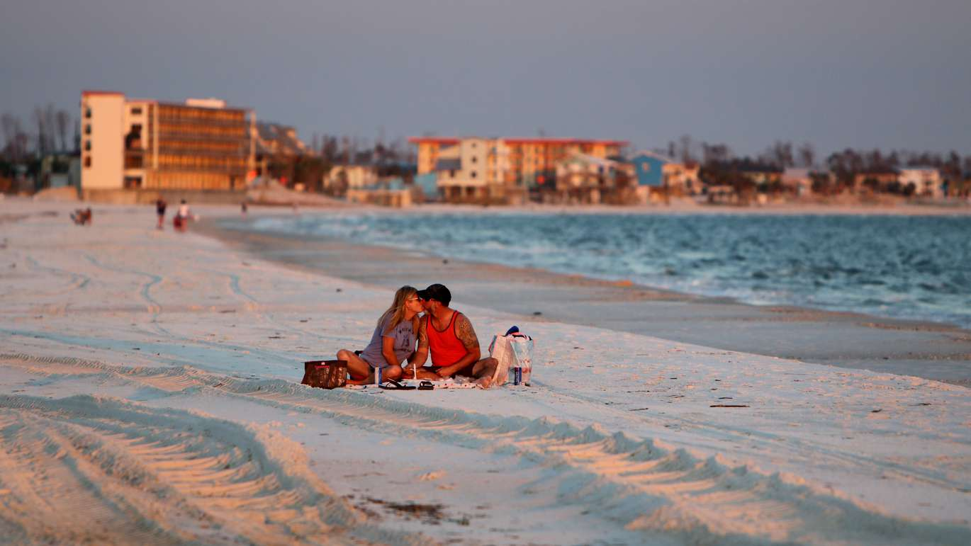 Chrissy Brown, left, lays a kiss on her husband Brian Brown, of Panama City, during a