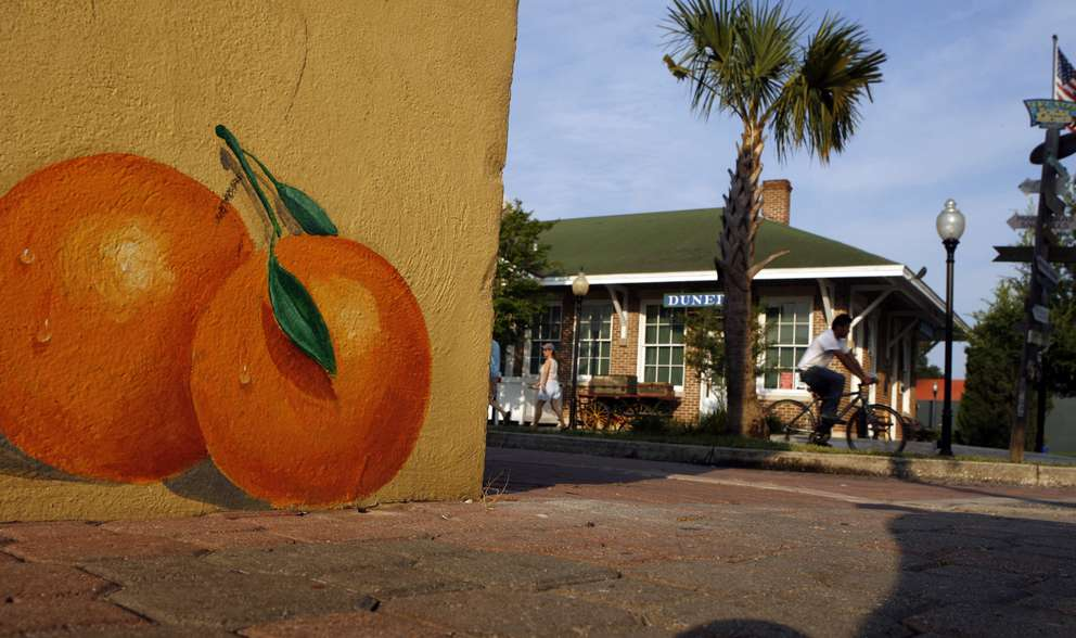 Photo of one of the numerous orange murals painted by Steve Spathelf. Times (2011)
