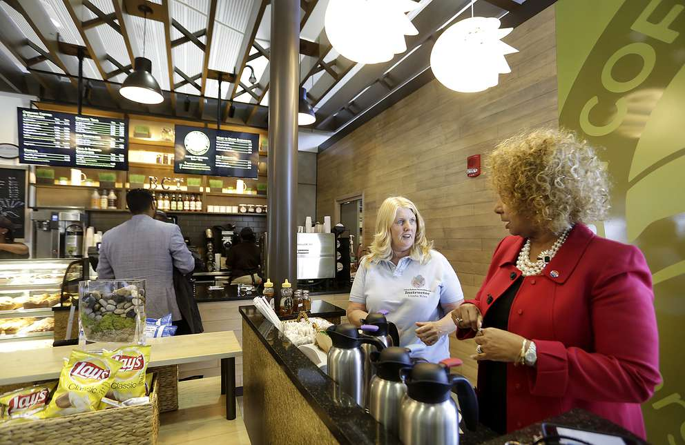 Linda Kiss, left, chats with Cheryl Hawkins, right, at the new Bay Coffee & Tea Company in the Airside A terminal at Tampa International Airport Thursday, Feb. 18, 2016. JAMES BORCHUCK I Times (2016)