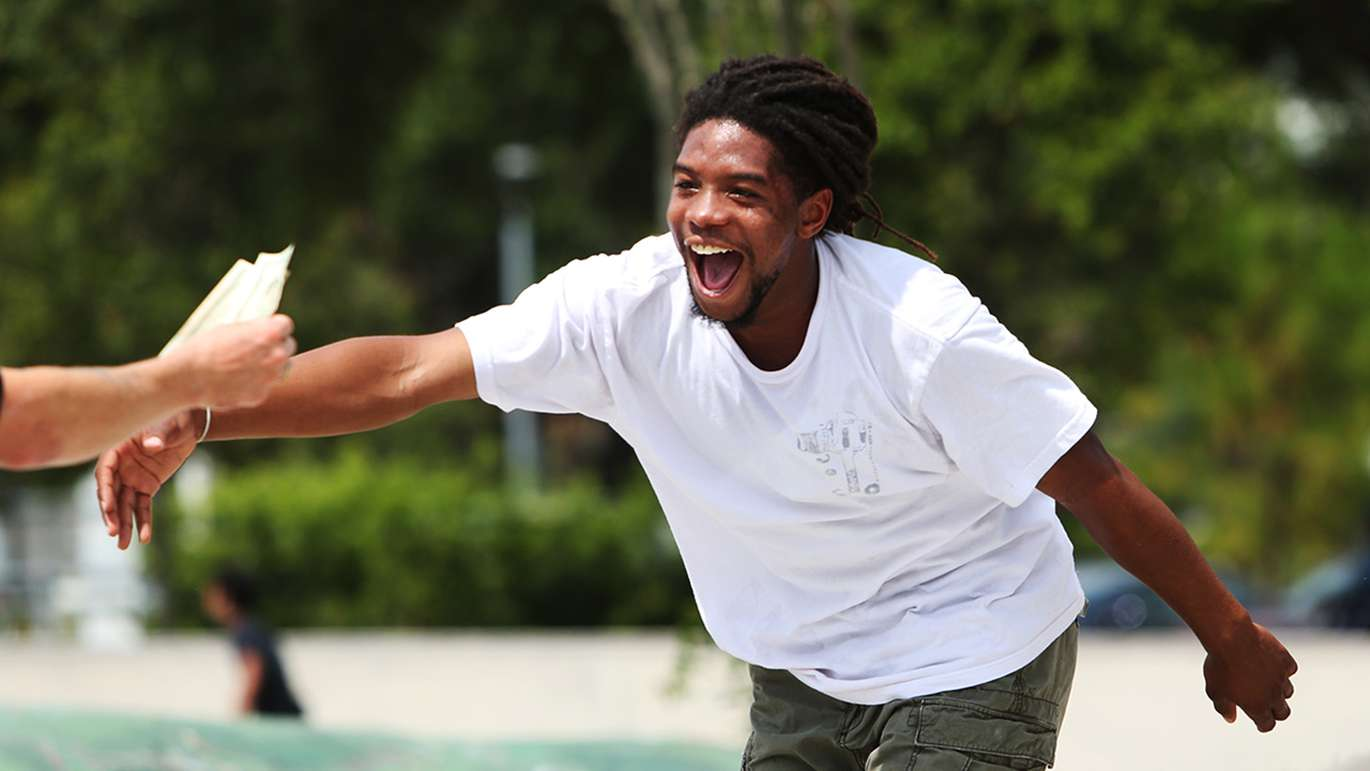 Markus Jalaber, 23, of Tampa, grabs $40 after completing a backside flip to flat during the Go Skateboarding Day at the Bro Bowl located at Perry Harvey Sr. Park Thursday, June 21, 2018 in Tampa.