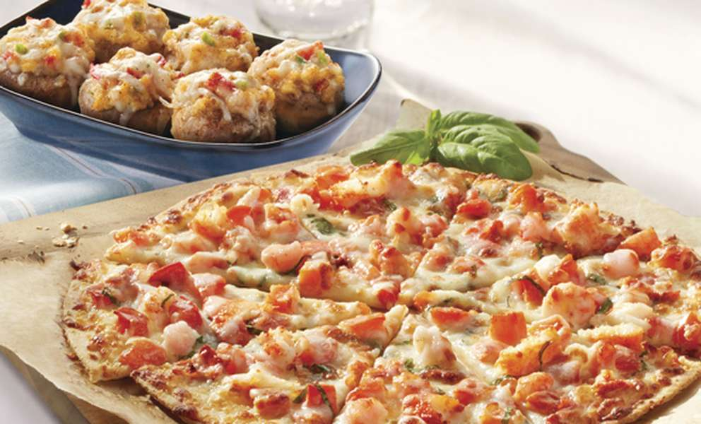 Red Lobster's Lobster and Langostino Pizza and Seafood-Stuffed Mushrooms are two options from a variety of appetizers and desserts being offered for free as part of its special Veterans Day menu. [Courtesy of Red Lobster]