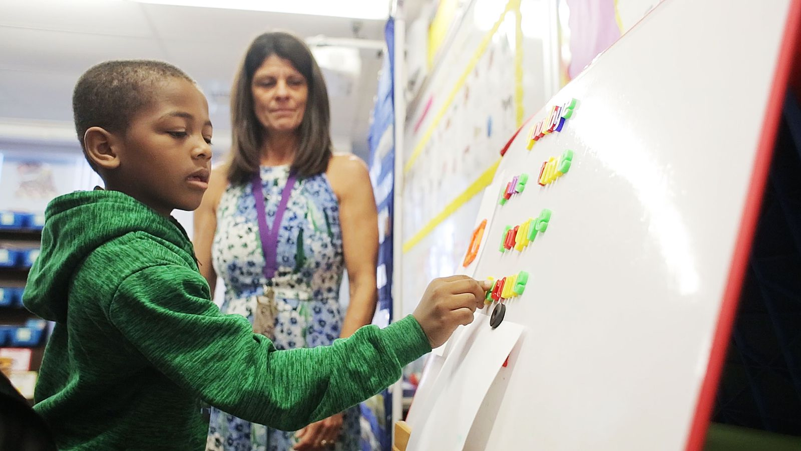 Specialist Patti Gonzales, who teaches reading lessons in small groups, works with Markus Barron at Booker T. Washington Elementary School in Tampa on Feb. 6.  [OCTAVIO JONES   |   Times]