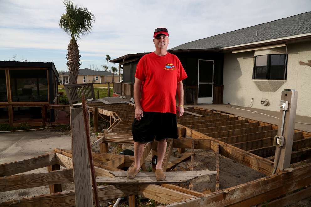 Hal Summers, 55, survived the landfall of Hurricane Michael by retreating into an outdoor bathroom with his cat, a neighbor and two dogs at his parent's home in Mexico Beach. DOUGLAS R. CLIFFORD | Times