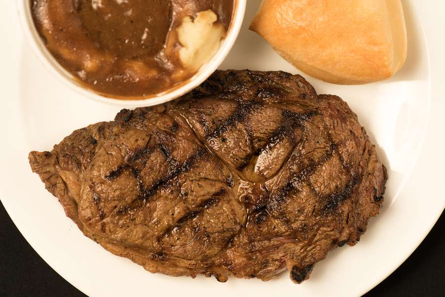 Almost anything featuring beef is a good idea at Texas Roadhouse, including hand-cut steaks such as this rib-eye. [Photo by Dixie D. Vereen for the Washington Post]