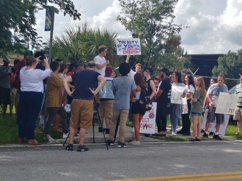 Sam Sharf, Parisa Akbarpour and other students who were local leaders of the post-Parkland gun control movement, led a protest up Harney Road. [MARLENE SOKOL | Times]