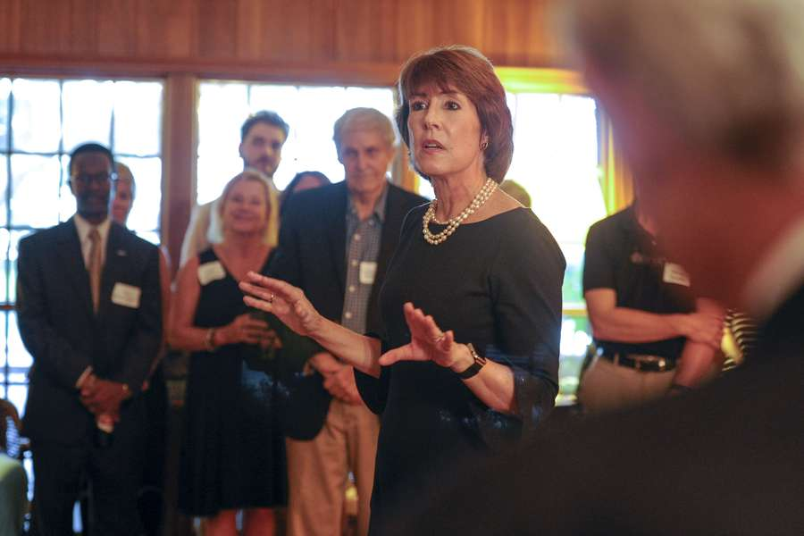 Florida gubernatorial candidate Gwen Graham, center, speaks during a private fundraiser at a Panama City home on Monday, Aug. 21, 2017. Graham spoke and answered questions from supporters during the fundraiser. [CHRIS URSO | Times]