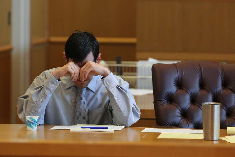 Defendant John Jonchuck covers his eyes with his hands for several minutes during jury selection Friday. [SCOTT KEELER | Times]