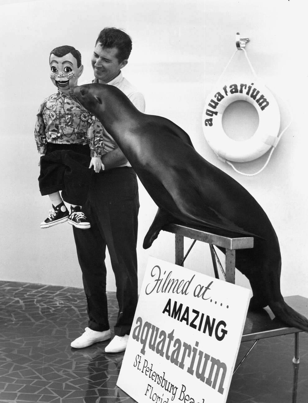 Bruce and Little Mike meet Toby the sea lion at the Aquatarium. [Times file]