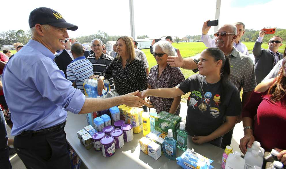 Florida Gov. Rick Scott thanks Osceola County volunteers who are assisting with the relief effort for Puerto Rico in the wake of Hurricane Maria during a visit to the Osceola County Services warehouse in Kissimmee on Wednesday, Sept. 27, 2017. ([oe Burbank | Orlando Sentinel via AP]
