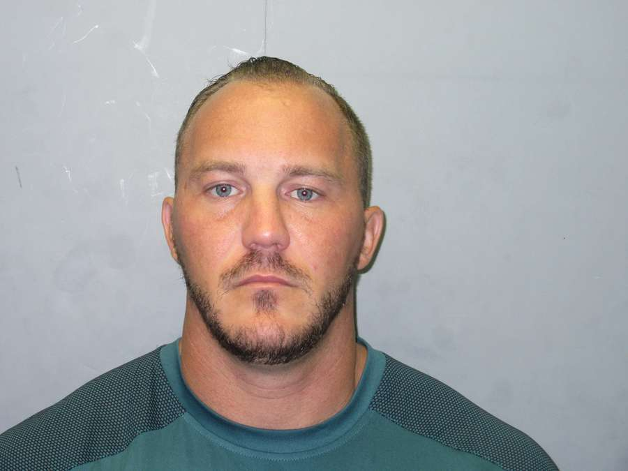 Former Hillsborough County firefighter Clinton Neal Walker was allegedly in the Outlaws motorcycle gang, prompting the county to ban participation in violent gangs.