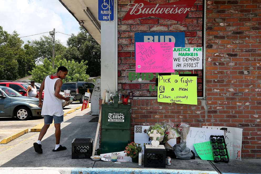 Days after Michael Drejka shot Markeis McGlockton, the Circle A Food Store became a memorial. [DOUGLAS R. CLIFFORD | Times]