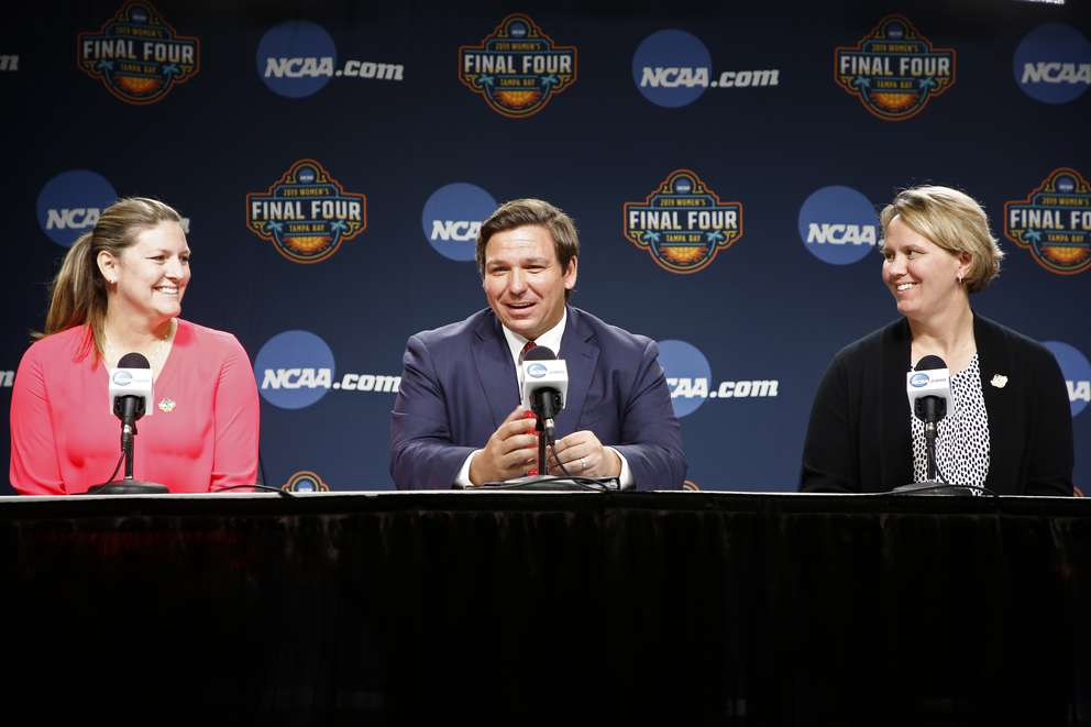 Florida Gov. Ron DeSantis during a news conference with Tampa Bay organizing committee executive director Claire Lessinger, left, and Lynn Holzman, vice president of women's basketball at the Women's Final Four NCAA college basketball tournament Saturday in Tampa. Notre Dame will play Baylor for the national championship on Sunday. (LUIS SANTANA | Times)